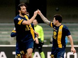 Luca Toni of Hellas Verona celebrates after scoring his teams first goal during the Serie A match between Hellas Verona FC and Juventus at Stadio Marc'Antonio Bentegodi on February 9, 2014