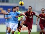 Alvaro Gonzalez of SS Lazio competes for the ball with Francesco Totti of AS Roma during the Serie A match between SS Lazio and AS Roma at Stadio Olimpico on February 9, 2014