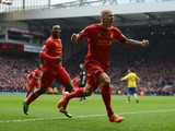 Martin Skrtel of Liverpool celebrates scoring the opening goal during the Barclays Premier League match between Liverpool and Arsenal at Anfield on February 8, 2014