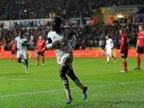 Swansea's Nathan Dyer celebrates after scoring this team's second goal against Cardiff during their Premier League match on February 8, 2014