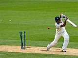 Rohit Sharma of India is bowled by Trent Boult of New Zealand during day three of the First Test match between New Zealand and India at Eden Park on February 8, 2014