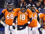 Quarterback Peyton Manning of the Denver Broncos leads his offense from the field on February 2, 2014