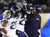 Cornerback Richard Sherman #25 of the Seattle Seahawks is helped off the field during the fourth quarter of Super Bowl XLVIII against the Denver Broncos on February 2, 2014