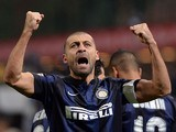 Inter's Walter Samuel celebrates after scoring the opening goal against Sassuolo on February 9, 2014