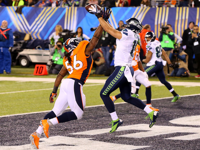 Wide receiver Jermaine Kearse #15 of the Seattle Seahawks tries to make a catch against outside linebacker Nate Irving #56 of the Denver Broncos on February 2, 2014