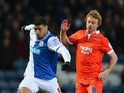 Leon Best of Blackburn Rovers competes with Chris Taylor of Millwall during the FA Cup sponsored by Budweiser Sixth Round Replay match between Blackburn Rovers and Millwall at Ewood Park on March 13, 2013