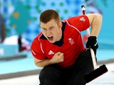 Greg Drummond of Great Britain competes in the men's round robin session against Germany during day four of the Sochi 2014 Winter Olympics at Ice Cube Curling Center on February 11, 2014