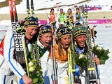 Gold medalists Ida Ingemarsdotter, Emma Wiken, Anna Haag and Charlotte Kalla of Sweden celebrate during the flower ceremony for the Women's 4 x 5 km Relay in Sochi on February 15, 2014