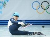 Great Britain's Jack Whelbourne falls as he competes in the Men's Short Track 1500 m Final at the Iceberg Skating Palace during the Sochi Winter Olympics on February 10, 2014