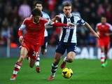 Adam Lallana of Southampton and James Morrison of West Bromwich Albion challenge for the ball during the Barclays Premier League match between Southampton and West Bromwich Albion at St Mary's Stadium on January 11, 2014