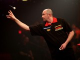 James Wilson of England in action during his first round match against Christian Kist of Holland during the BDO Lakeside World Professional Darts Championships at Lakeside Complex on January 07, 2014