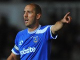 Portsmouth player Joe Devera reacts during the Johnstone's Paint Trophy southern section quarter final game against Newport County AFC on November 12, 2013