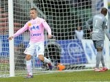 Evian's Kevin Berigaud celebrates after scoring his team's opening goal against Lille during their Ligue 1 match on February 16, 2014