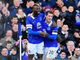 Everton's Lacina Traore celebrates with teammate Ross Barkley after scoring the opening goal against Swansea during their FA Cup fifth round match on February 9, 2014