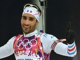 Gold medalist France's Martin Fourcade celebrates his win in the Men's Biathlon 12,5 km Pursuit at the Laura Cross-Country Ski and Biathlon Center during the Sochi Winter Olympics on February 10,