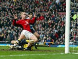 Paul Scholes scores the first goal for his team past Manchester City's goalkeeper Ari Arason on February 14, 2004