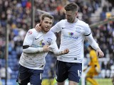 Joe Garner of Preston North End celebrates with team-mate Jake Larkins after he scores the first goal of the game for his side fr