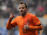 Dutch midfielder Rafael van der Vaart celebrates after scoring during the friendly football match between Japan and Netherlands at the Fenix Stadium, on November 16, 2013 in Genk