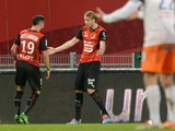Rennes' forward Ola Toivonen celebrates with Romain Alessandrini after scoring during the French L1 football match between Rennes and Montpellier on February 15, 2014