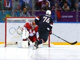 T.J. Oshie of the United States scores on a shootout against Sergei Bobrovski #72 of Russia during the Men's Ice Hockey Preliminary Round Group A game on February 15, 2014