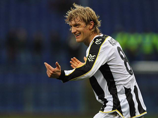 Udinese's Dusan Basta celebrates after scoring the opening goal against Genoa during their Serie A match on February 16, 2014