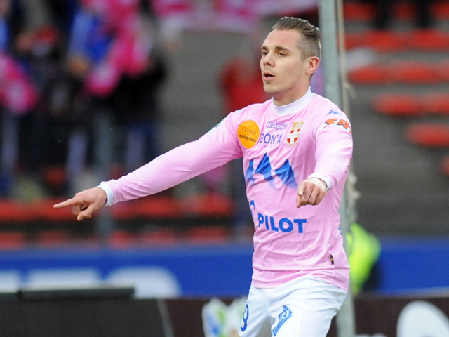 Evian's French forward Kevin Berigaud celebrates after scoring during the French L1 football match between Evian (ETGFC) and Lille (LOSC) on February 16, 2014