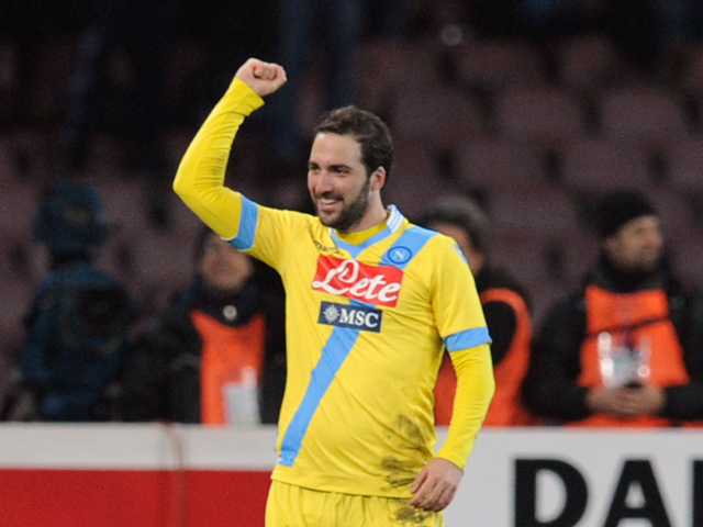 Gonzalo Higuain of Napoli celebrates after scoring goal 2-0 during the TIM Cup match between SSC Napoli and AS Roma at Stadio San Paolo on February 12, 2014