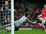 Lukasz Fabianski of Arsenal makes a save during the UEFA Champions League Round of 16 first leg match between Arsenal and FC Bayern Muenchen at Emirates Stadium on February 19, 2014