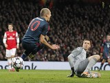 Bayern Munich's Dutch midfielder Arjen Robben is fouled by Arsenal's Polish goalkeeper Wojciech Szczesny during the UEFA Champions League Last 16, first leg football match between Arsenal and Bayern Munich at The Emirates Stadium in north London on Februa