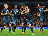 Bayern Munich's midfielder Toni Kroos celebrates after scoring his team's first goal during the UEFA Champions League Last 16, first leg football match between Arsenal and Bayern Munich at The Emirates Stadium in north London on February 19, 2014