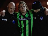 Craig Mackail-Smith is helped off the pitch after picking up an injury during the npower Championship match between Bristol City and Brighton & Hove Albion at Ashton Gate on March 5, 2013