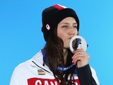 Silver medalist Kelsey Serwa of Canada celebrates during the medal ceremony for the Women's Ski Cross on day fourteen of the Sochi 2014 Winter Olympics at Medals Plaza on February 21, 2014