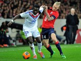 Lille's Danish defender Simon Kjaer vies for the ball with Lyon's French forward Bafetimbi Gomis during the French L1 football match Lille (LOSC) vs Lyon (OL) on February 23, 2014