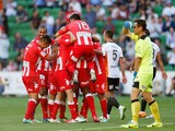Melbourne players celebrate a Orlando Engelaar goal during the round 20 A-League match between Melbourne Heart and Brisbane Roar at AAMI Park on February 23, 2014
