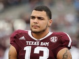 Mike Evans #13 of the Texas A&M Aggies waits on the field before the game against the Mississippi State Bulldogs at Kyle Field on November 9, 2013