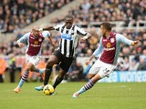 Moussa Sissoko of Newcastle United looks to get past Ryan Bertrand of Aston Villa during the Barclays Premier League match between Newcastle United and Aston Villa at St James' Park on February 23, 2014