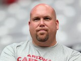 General Manager Steve Keim of the Arizona Cardinals watches practice during the team training camp at University of Phoenix Stadium on July 29, 2013