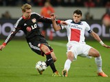 Paris Saint-Germain's Brazilian defender Thiago Silva and Leverkusen's striker Stefan Kiessling vie for the ball during the first-leg round of 16 UEFA Champions League football match on February 18, 2014