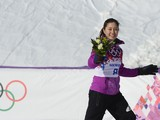 Silver Medallist, Japan's Tomoka Takeuchi celebrates at the Women's Snowboard Parallel Giant Slalom Flower Ceremony at the Rosa Khutor Extreme Park during the Sochi Winter Olympics on February 19, 2014