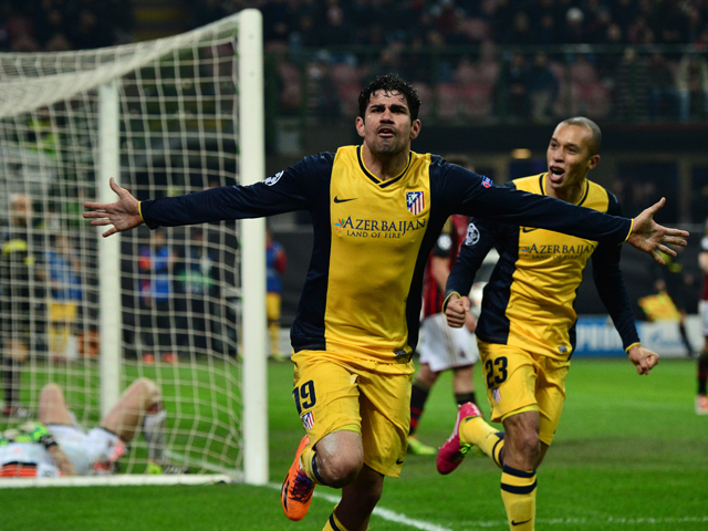 Atletico Madrid's Brazilian forward Diego da Silva Costa celebrates after scoring a goal with his teammate Brazilian defender Joa Miranda de Souza during the Champions league match AC Milan vs Atletico Madrid at the San Siro Stadium in Milan on February 1