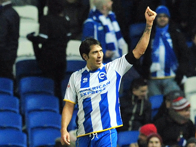Brighton & Hove Albion's Argentine striker Leonardo Ulloa celebrates after scoring his team's first goal during the English FA Cup fifth round football match between Brighton & Hove Albion and Hull City at The American Express Community Stadium in Brighto