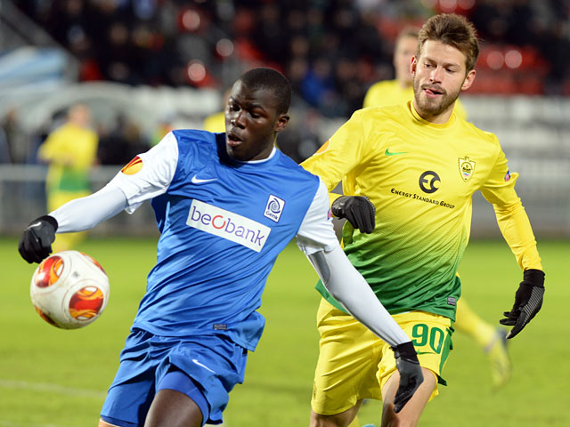 Genk's Kalidou Koulibaly and Anzhi Makhachkala's Fedor Smolov in action during their Europa League match on February 20, 2014