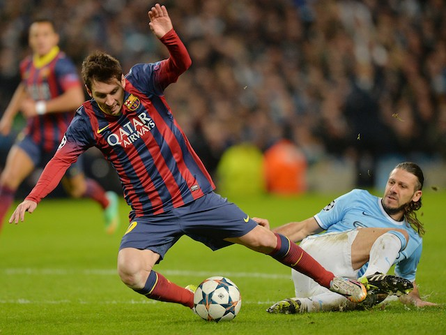 Manchester City's Martin Demichelis fouls Barcelona's Lionel Messi to give a penalty during a UEFA Champions League Last 16 match on February 18, 2014