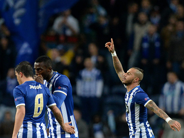 Porto's Ricardo Quaresma celebrates with teammates after scoring against Frankfurt during their Europa League match on February 20, 2014