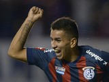 San Lorenzo midfielder Angel Correa celebrates after scoring against Ecuador's Independiente del Valle during their Libertadores Cup Group 2 football match on February 27, 2014