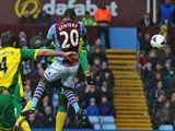 Aston Villa's Zaire-born Belgian striker Christian Benteke jumps to score their first goal during the English Premier League football match between Aston Villa and Norwich City at Villa Park in Birmingham on March 2, 2014