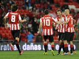 Athletic Bilbao's midfielder and captain Carlos Gurpegi celebrates with teammates his team's fourth goal during the Spanish league football match Athletic Club Bilbao vs Granada CF at the San Mames stadium in Bilbao on February 28, 2014