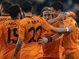 Real's Cristiano Ronaldo celebrates with teammates after scoring his team's third goal against Schalke during their Champions League match on February 26, 2014