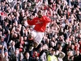 Dwight Yorke celebrates scoring for Manchester United against Arsenal on February 25, 2001.