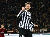 Juventus' Spanish foward Fernando Llorente (L) celebrates after scoring a goal during the Serie A football match between AC Milan and Juventus at San Siro stadium in Milan on March 2, 2014